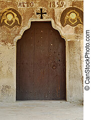 Old orthodox small village church side wooden door
