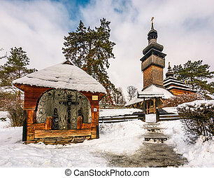 old orthodox wooden church in winter. location Museum of...
