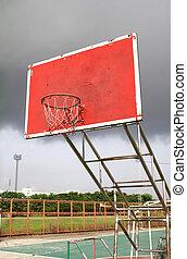 old outdoor basketball hoop agains