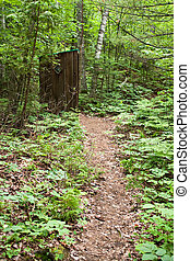 Old Outhouse in the Woods - An old outhouse on the trail...