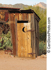 Old Outhouse - Old western style outhouse in a ghost town