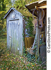Old Outhouse - An old rustic outhouse somewhere in rural...