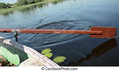 old paddle water - brown old wooden paddle bounces into the...
