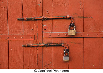 old padlock locking the wooden door - The padlock locking...