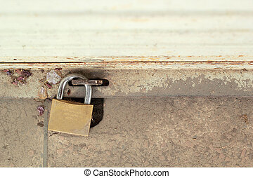 Old padlock on a steel door