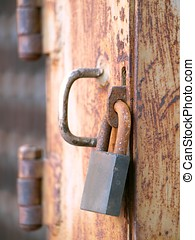 Old Padlock on Rusty Door - A rusty old padlock on a...