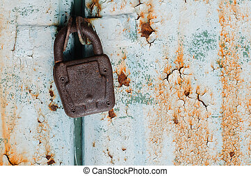 Old padlock on rusty door - Old padlock on rusty metal...