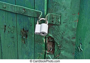 old padlock on the door closed