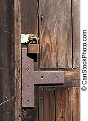 Old padlock on wooden door - Old padlock on a wooden door,...