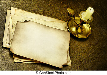 Old pages and candle