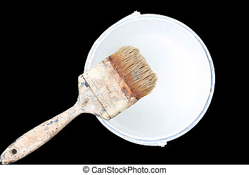 Old paint brush rest on top of  paint tin isolated