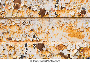 Old paint on a rusty iron sheet