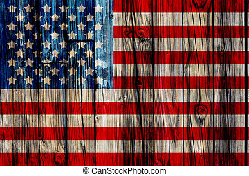 Old Painted American Flag on Dark Wooden Fence