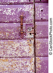 Old painted, crumbled door. - Background of an old painted,...