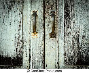 Old painted door with handles