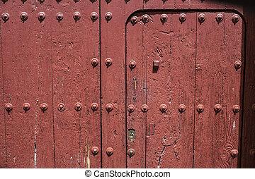 Old painted typical wooden door at Zalamea de la Serena