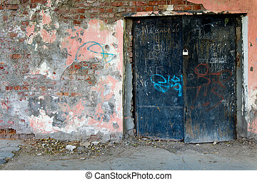 Old painted wall  with black iron gates closed front view