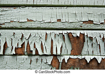 Old Painted Wooden Siding - Peeling paint on an old wooden...
