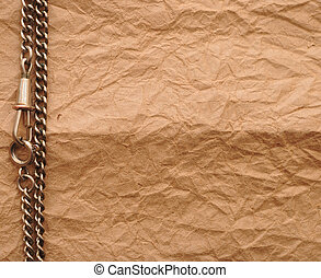old paper and silver chain with copy space