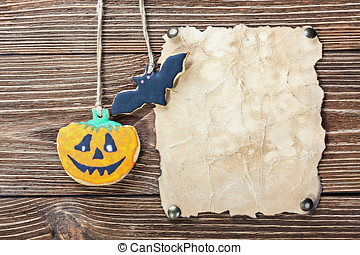 Old paper for congratulations with Halloween and homemade cookie