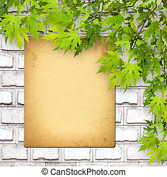 Old paper listing on white brick wall with bright green foliage