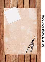 Old paper on a wooden desk with fountain pen