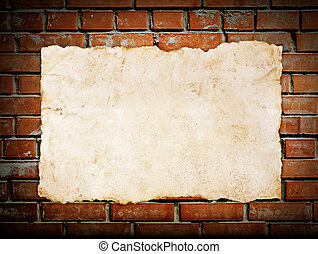 old paper on brickwall