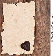 old paper on brown wood texture