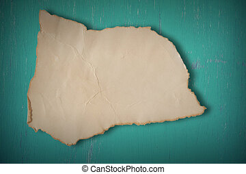 Old paper on grunge green wooden background