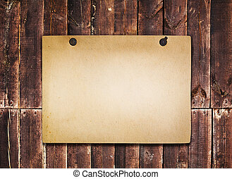 Old paper on grunge wood background