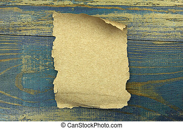Old paper on the blue wood background