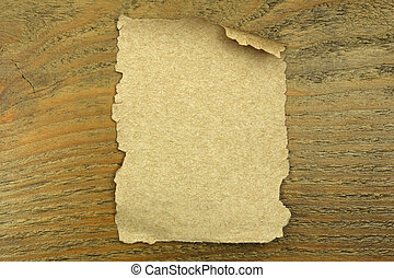 old paper on the wooden background