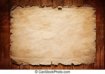 Old paper on wooden board