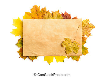old paper page on fall leaves