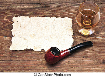 old paper, pipe and glass of cognac