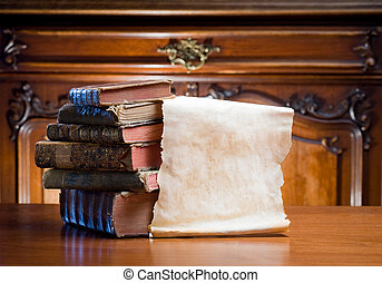 Old paper scroll with antique books.