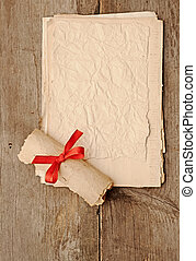 old paper sheets with old paper roll