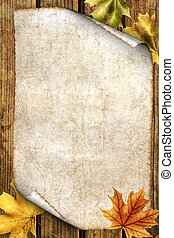 old paper with autumn leaves on wood