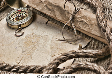 old paper with compass and rope