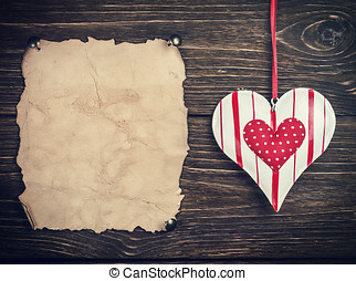 Old paper with heart. toned image - Old paper with heart and...
