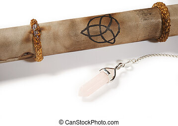 Old parchment with crystal pendulum for divination