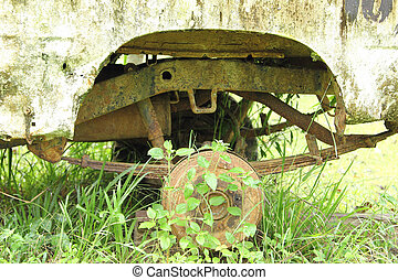 Old part of wheel car in the garden