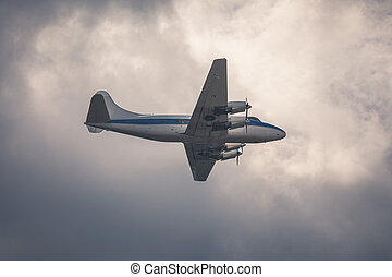 Old passenger plane on cloudy sky - DC-3 old passenger plane...