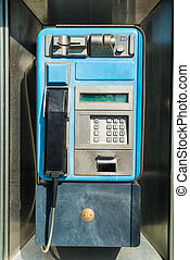 Old payphone in working order inside a phone box