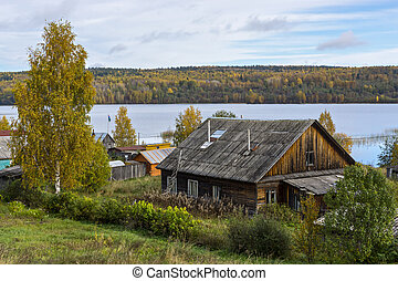 Old peasant house on lake shore