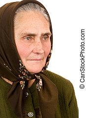 Close-up portrait of an old peasant woman isolated on white background