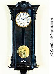 old pendulum clock on wall
