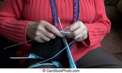 old pensioner woman hands knitting
