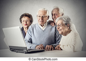 Old people looking at laptop