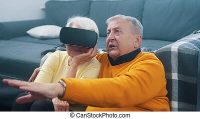 Old people using new headset goggles trends technology . High quality 4k footage